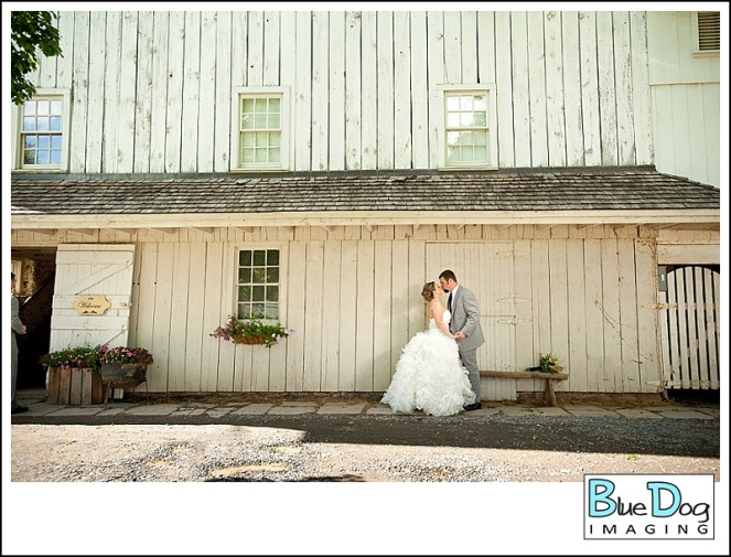 barn-at-boones-dam-wedding-venue-couple-by-barn